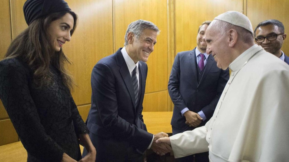 Pope Francis shaking hands with George Clooney and his wife (Credit: EPA)