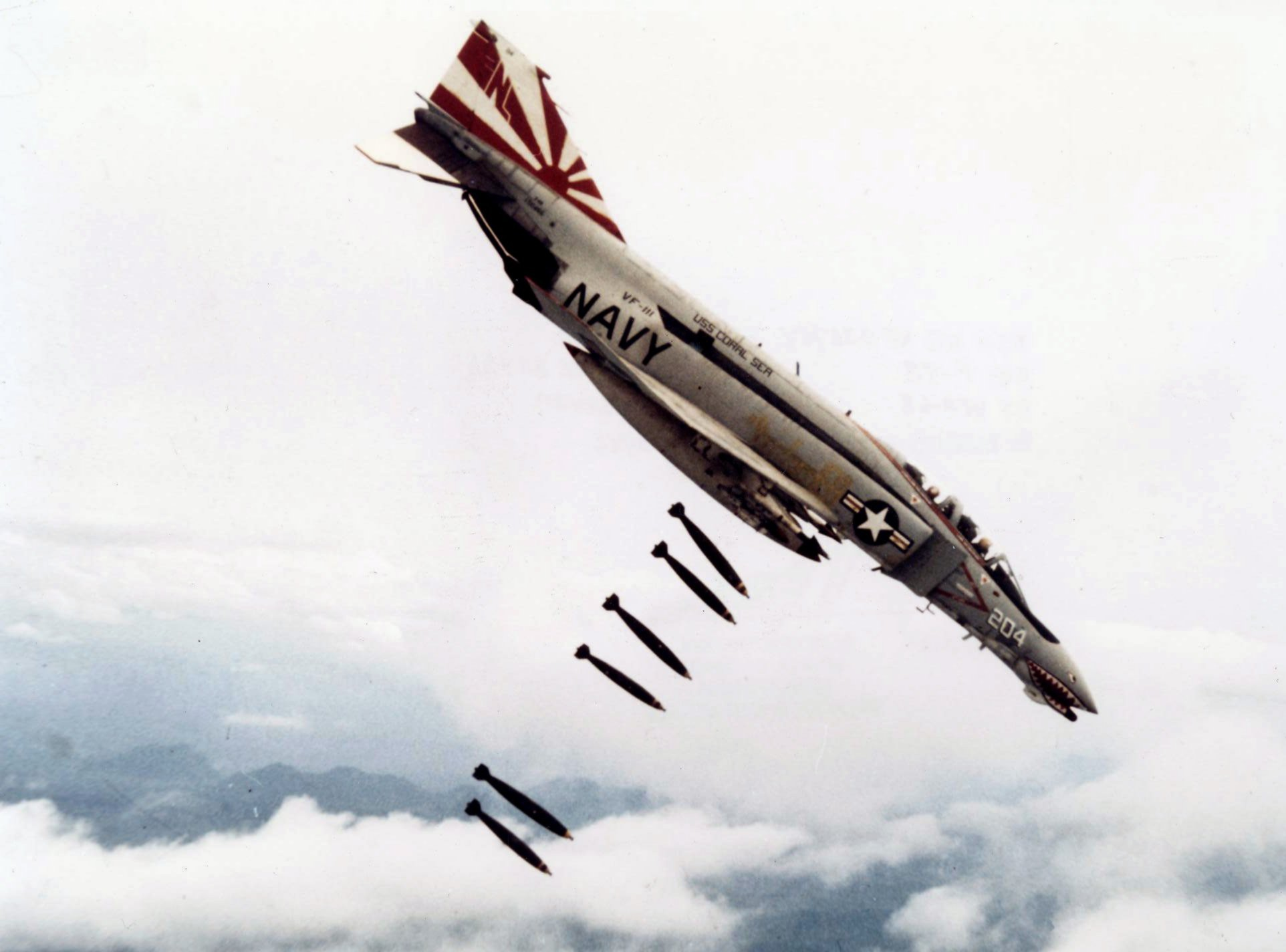 US Navy F-4B dropping bombs over Vietnam in 1971 (Photo Credit: US Navy National Museum of Naval Aviation)